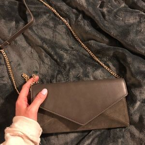 Grey clutch with gold chain strap by Madison West